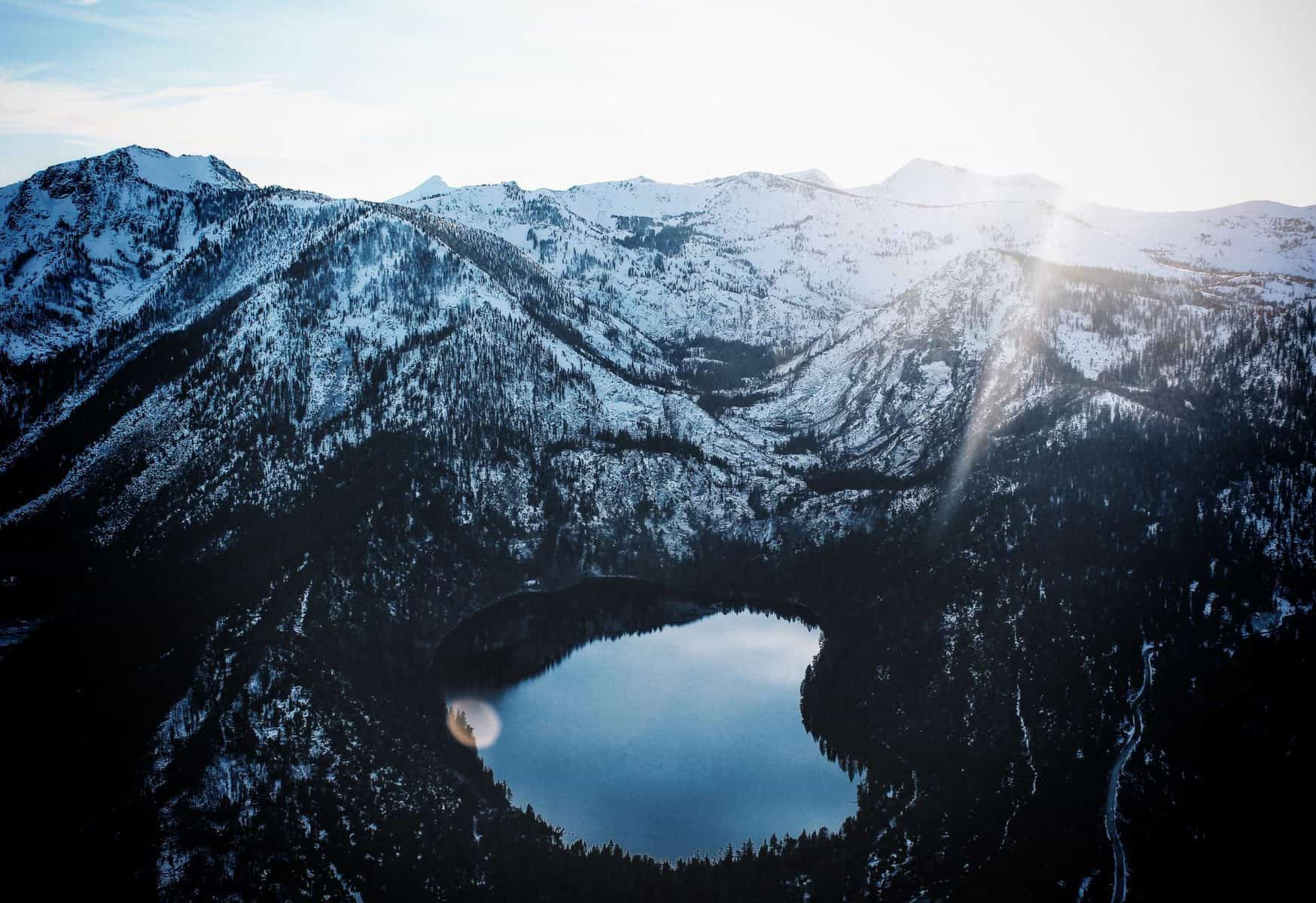 lake between mountains in winter