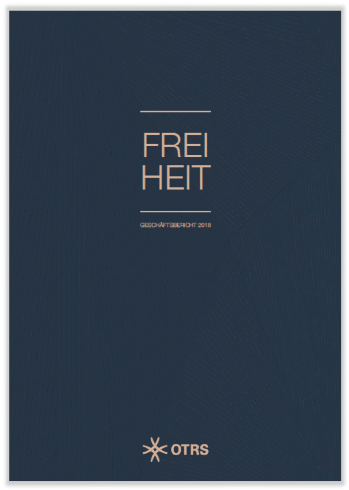 "Dark grey cover of annual report 2018 with the word ""Freedom"" in the middle"