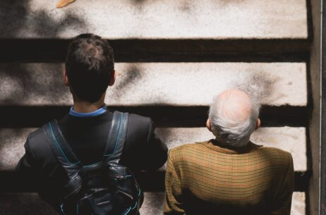 old and young men walking on stairs